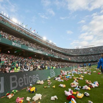 SEVILLE, SPAIN - DECEMBER 22: Real Betis fans throw stuffed animals to be collected and given to children in need during the Liga match between Real Betis Balompie and Club Atletico de Madrid at Estadio Benito Villamarin on December 22, 2019 in Seville, Spain. (Photo by Quality Sport Images/Getty Images)